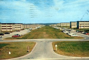 Front side of postcard, photo of Fort Ord, California